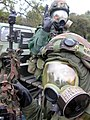 US Navy 030414-N-1485H-001 Seabees assigned to Naval Mobile Construction Battalion Forty (NMCB-40) don protective suits during a simulated chemical-biological attack conducted during a field training exercise.jpg