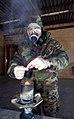 US Navy 040110-N-6157F-018 Marine Gysgt. Victor Szalankiewicz, the Marine advisor to Naval Mobile Construction Battalion Two Three (NMCB-23) burns tear gas.jpg