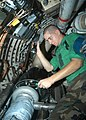 US Navy 040706-N-2591H-001 Aviation Structural Mechanic Airman Apprentice Patrick Carrington, from Marshall Mich., cleans excess grease from the radar system of a S-3B Viking.jpg