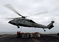 US Navy 040716-N-7532C-009 A MH-60 Knighthawk assigned to the Chargers of Helicopter Combat Support Squadron Six (HC-6) delivers supplies during a replenishment at sea (RAS) aboard USS Harry S. Truman (CVN 75).jpg