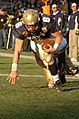US Navy 041204-N-9693M-008 Navy Quarter Back Aaron Polanco scores for Navy at the 105th Army Navy game.jpg