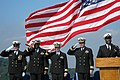 US Navy 051013-N-6106R-010 Chief Aviation Boatswain's Mate Michael Berry, far left, and members of the official party salute as the national anthem is sung during Berry's retirement ceremony.jpg