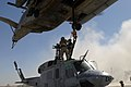 US Navy 051025-M-6538A-010 U.S. Marines assigned to Combat Logistics Battalion Two hook-up a UH-1N Huey helicopter.jpg