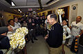 US Navy 051202-N-9693M-002 Chief of Naval Operations Mike Mullen explains to the Army cheerleader squad that the Navy will be victorious during the upcoming 106th Army-Navy football game.jpg