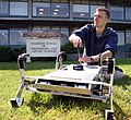 US Navy 060427-N-1825C-001 Combat Systems Sciences and Technology Program Naval Postgraduate student Ensign Tom Dunbar, works with an autonomous robot originally designed to maneuver in agricultural settings.jpg