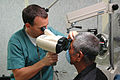 US Navy 060526-N-3532C-045 U.S. Navy Ophthalmologist, Lt. Cmdr. Frank Bishop, M.D., conducts an eye exam for a local resident aboard Military Sealift Command hospital ship USNS Mercy.jpg