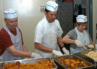 Image of people volunteering in a soup kitchen