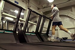 US Navy 070406-N-7130B-187 In the aft gym aboard the aircraft carrier USS Ronald Reagan (CVN 76), Master Chief Electronics Technician James Poletto, from New Milford, Conn., runs on the treadmill.jpg