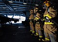 US Navy 070727-N-7981E-083 A hose team assigned to repair locker 1B fights a simulated aircraft fire during a General Quarters (GQ) drill in the hangar bay of Nimitz-class aircraft carrier USS Abraham Lincoln (CVN 72).jpg
