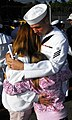 US Navy 090120-N-9698C-018 Culinary Specialist Seaman Jeff Norman, assigned to the guided-missile destroyer USS Hopper (DDG-70), hugs his wife good-by.jpg