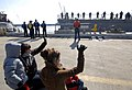 US Navy 090229-N-7544A-092 Family members wave good-bye to Sailors aboard the guided-missile destroyer USS Laboon (DDG 58) as the ship leaves its homeport of Norfolk for a six-month deployment.jpg