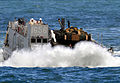 US Navy 090515-N-5345W-206 A landing craft unit from Assault Craft Unit (ACU) 2 crashes through the surf as it approaches the well deck of the Whidbey Island-class amphibious dock landing ship USS Fort McHenry (LSD 43).jpg