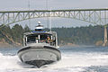US Navy 090723-N-3577H-004 A patrol boat assigned to Maritime Expeditionary Security Squadron (MSRON) 9 passes under the Deception Pass Bridge on its way to an annual training exercise in Puget Sound.jpg