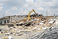 US Navy 090813-N-2468S-004 A bulldozer tears down the last operational wooden building at Naval Construction Battalion Center, Gulfport.jpg