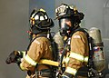 US Navy 090819-N-9573A-014 Fire fighters Min Hwan Pak (right), looks back as Sang Chun An (left), both Chinhae residents, prepare to enter a smoke-filled space during a fire saboteur drill.jpg