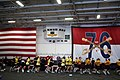 US Navy 090913-N-9818V-065 Sailors aboard the aircraft carrier USS Ronald Reagan (CVN 76) conduct morning physical training in the hangar bay of the ship.jpg