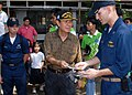 US Navy 091026-N-6692A-060 Olongapo City Mayor James Gordon presents compact discs to Lt. Adam Stein, the operations officer aboard the dock landing ship USS Tortuga (LSD 46).jpg
