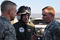 US Navy 100115-N-6247V-118 Rear Adm. Ted N. Branch, center, commander, Carrier Strike Group (CSG) 1, speaks with Army Lt. Gen. Keen, right and Air Force Col. Ament, left upon his arrival in Haiti Jan. 15.jpg