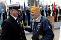 US Navy 100410-N-9818V-057 Master Chief Petty Officer of the Navy (MCPON) Rick West talks with Thomas Russell III at a memorial service.jpg