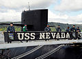 US Navy 100506-N-1325N-005 Sailors aboard USS Nevada (SSBN 733) secure the submarine's banner to the brow at Naval Base Kitsap.jpg