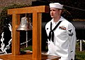 US Navy 100527-N-1125B-001 Sonar Technician 2nd Class Cory Miller, assigned to Submarine Learning Facility Norfolk, stands by as the bell ringer at the annual Submarine Veterans of World War II Memorial Service at Naval Station.jpg