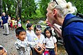 US Navy 100621-N-6410J-027 Religious Programs Specialist 1st Class Jennifer Snow blows bubbles with students at Ohtres Chas Primary School.jpg