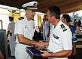 US Navy 100630-N-3570S-031 Capt. Gregory R. Thomas presents French navy Cmdr. Renaud Bondil, commanding officer of the French navy frigate Prairial (F 731).jpg
