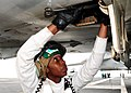 US Navy 100808-N-3327M-013 Aviation Machinist's Mate 3rd Class Kenya Mittle, from Golesboro, N.C., replaces an engine filter for an F-A-18C Hornet before flight operations aboard the aircraft carrier USS Nimitz (CVN 68).jpg