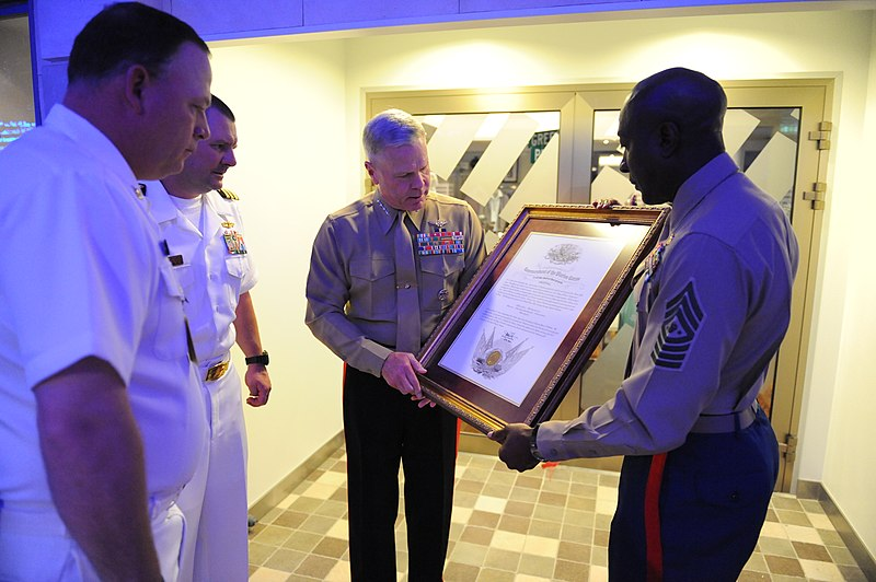 File:US Navy 101113-M-2581P-006 Marine Corps Gen. James F. Amos, center, and Sgt. Maj. of the Marine Corps Carlton W. Kent, right, present a framed cert.jpg