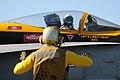 US Navy 101202-N-0844M-006 A flight deck crewman directs an F-A-18C Hornet aboard USS Abraham Lincoln (CVN 72).jpg