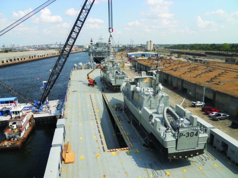 File:US Navy 110609-N-YY999-001 A crane loads two U.S.-built patrol boats onto the Maritime Administration Ready Reserve Force roll-on-roll-off ship MV.jpg