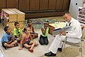 US Navy 110713-N-NT881-125 eaman Apprentice Chris Donahue, assigned to Navy Operation Support Center Rochester, reads to children at the Cameron Co.jpg