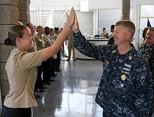 High five - A high five between two U.S. Navy Sailors