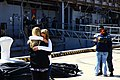 US Navy 111003-A-WF228-022 amily Members say goodbye to their loved ones as the amphibious dock landing ship USS Oak Hill (LSD 51) departs.jpg