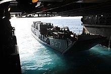 US Navy 111011-N-WA347-041 Landing craft utility (LCU) 1627 departs the well deck of the forward-deployed amphibious assault ship USS Essex (LHD 2).jpg