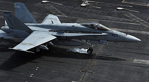 US Navy 120216-N-VO377-423 An F-A-18C Hornet assigned to the Blue Blasters of Strike Fighter Squadron (VFA) 34 lands on the flight deck of the Nimi.jpg