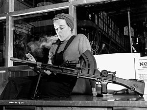 "Feminism in Canada - Veronica Foster, popularly known as ""Ronnie, the Bren Gun Girl"" on the production line. Many women worked ""on the home front"" during the war."