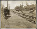 View south on Alki Avenue during regrade, showing rail tracks and homes, West Seattle, August 19, 1913 (MOHAI 8718).jpg