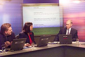 Gazeta.ru - Vladimir Putin in March 2001 during online news conference with BBC correspondent Bridget Kendall and Editor-in-Chief of Gazeta.ru Vladislav Borodulin