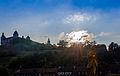 Würzburg, Veste Marienberg im Licht der untergehenden Sonne (rechts der heilige Kolonat, einer der Frankenapostel auf der alten Mainbrücke - jetzt wieder mit neuem Dolch) (10609609165).jpg