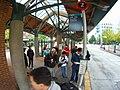 Waiting to board the B Line (6202906402).jpg