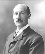 Walter Camp, a balding man with a mustache
