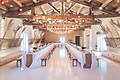 Wedding reception tables and benches (Unsplash).jpg