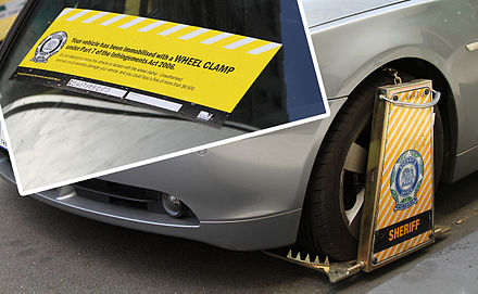 Vehicles may be wheel clamped for parking violations, such as this one in Melbourne, as a penalty or to enforce payment of fines Wheel clamped BMW5Series Combo, Little Collins St, Melb, 19.10.2011, jjron.jpg