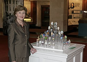 White House Visitors Office - Interior of the White House Visitors Center, April 2007. First Lady of the United States Laura Bush stands next to 51 State Eggs decorated by artists from each state and D.C.