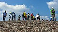 Wide view of tourists at top of Pyramid of the Sun, Teotihuacan.jpg