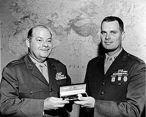 William McMillan (sport shooter) - Thomas A. Wornham (MCRD San Diego) decorating William W. McMillan with Elgin Wrist Watches for National Rifle and Pistol Matches 1957.
