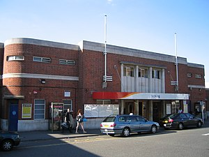 Woking railway station - The station's southern exterior is an art deco rounded-edge building in a mixture of concrete and stock brick courses.  It features less uniformity and glass than the town centre side