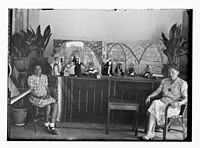 Woman and girl seated in front of dolls which are wearing traditional Arab dress; one group of dolls has label 'Dolls Ramallah' LOC matpc.12236.jpg