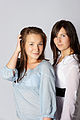 Woman in white Shirt and black pants and Woman in blue shirt and white pants 02.jpg